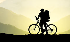 Active life concept. Silhouette of a bike and tourist. Active life concept Royalty Free Stock Images