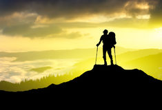 Active life concept. Silhouettes of tourist on mountain peak. Sport and active life concept Stock Images