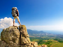 Active life concept. Tourist on high mountain peak. Sport and active life concept Stock Photo