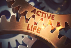 Active Life on Golden Metallic Cogwheels. 3D Illustration. Royalty Free Stock Photo