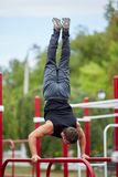 Active life and sport concept. Work out male. Athletic body. Sporty young man working out at early morning male jogger exercising, runner working out outdoors Stock Image