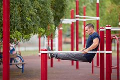 Active life and sport concept. Work out male. Athletic body. Sporty young man working out at early morning male jogger exercising, runner working out outdoors Stock Photo