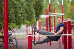 Active life and sport concept. Work out male. Athletic body. Sporty young man working out at early morning male jogger exercising, runner working out outdoors Royalty Free Stock Images