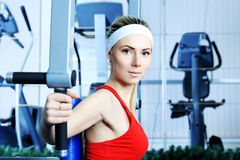 Active lifestyle. Young sporty woman in the gym centre Stock Photos
