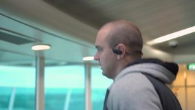 Portrait of young sportsman jogging in gym in headphone stock video footage