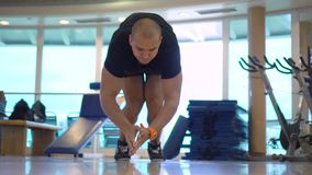 Young sportsman makes pushups exercise with claps in gym stock footage