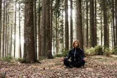 Active lifestyle - healthy lifestyle. Relaxing in the nature.. Outdoor activities and meditating in wood. Unspoiled and healthy forest stock photo