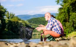 Active lifestyle and hobby. fly fish hobby of men. retirement fishery. Two male friends fishing together. big game