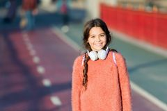 Active lifestyle music play list. Girl cute child with headphones. Reasons you should use headphones. Headphones changed. World. Headphones bring privacy to stock photos