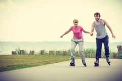 Roller skater couple skating outdoor Royalty Free Stock Photography
