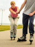 Roller skater couple skating outdoor Stock Photo