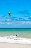 Active lifestyle sport background. Kite surfer near ocean coast Stock Photo
