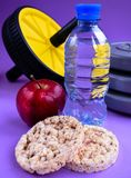 Active lifestyle sport water apple oatmeal loaves gymnastic wheel royalty free stock photo