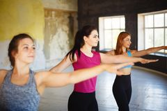 Fit women dancing zumba in gym. royalty free stock photography