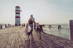 Active lifestyle woman with dog posing outdoor stock images