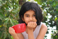 Active listener. A girl with full concentration listening with a rapt attention Royalty Free Stock Photography