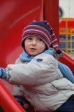 Active little boy. The little boy sitting at the nursery chute Stock Photos