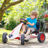 Active little boy having fun and driving toy race car Stock Photos