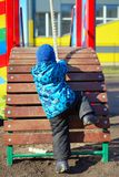 Active little boy on playground Stock Photography
