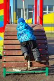 Active little boy on playground Royalty Free Stock Photos
