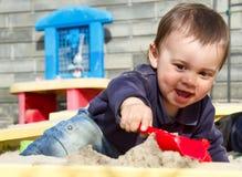 Active little boy on playground. playing child in sandbox Stock Image