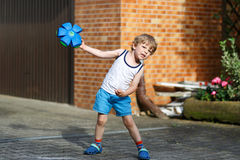 Active little boy playing with ball toy Royalty Free Stock Photos