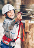 Active little boy on the rope park attraction Stock Image