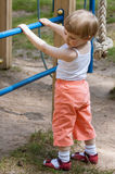 Active little child climbing on a ladder Stock Photos