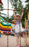 Active little girl climbing on a ladder Stock Photography