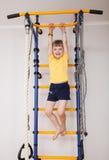 Active little girl doing sport exercises Stock Photography