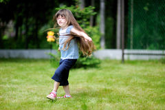 Active little girl with long dark Royalty Free Stock Photo
