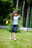 Active little girl with long dark Royalty Free Stock Photography