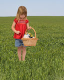 Active little girl picking up litter stock photos