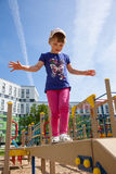 Active little girl. On playground Royalty Free Stock Photography