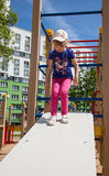 Active little girl. On playground Stock Image