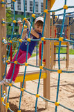 Active little girl. On playground Royalty Free Stock Image