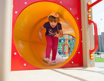 Active little girl. On playground Royalty Free Stock Images