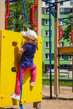 Active little girl. On playground Stock Images