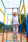 Active little girl on playground. On park Royalty Free Stock Images