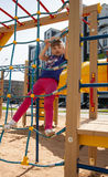 Active little girl on the playground. Active little girl playing on the playground Royalty Free Stock Photography