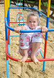 Active little girl on playground. In summer Royalty Free Stock Photos