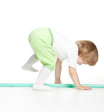 Active little girl playing with a sport stick Stock Photos