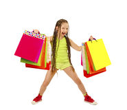 Active little girl with shopping bags Royalty Free Stock Image