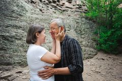 Active loving senior couple walking in beautiful summer forest royalty free stock photo