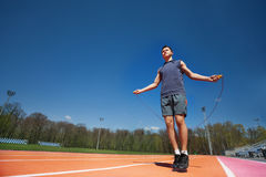 Active male athlete skipping the rope outside Royalty Free Stock Photography