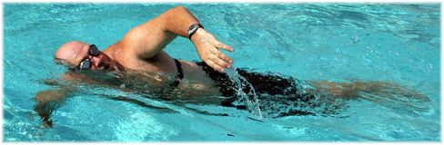 Active Man. Man Swimming in a pool Stock Images