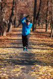 Active man. Young man doing fitness in a park in autumn Royalty Free Stock Image