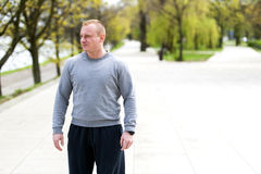 Active man with athletic body, exercise outdoor in park. Fit look Stock Photo