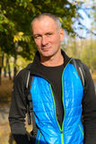 Active man with backpack in a autumn park. Royalty Free Stock Image