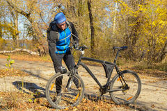 Active man with bicycle in a autumn forest. Stock Images